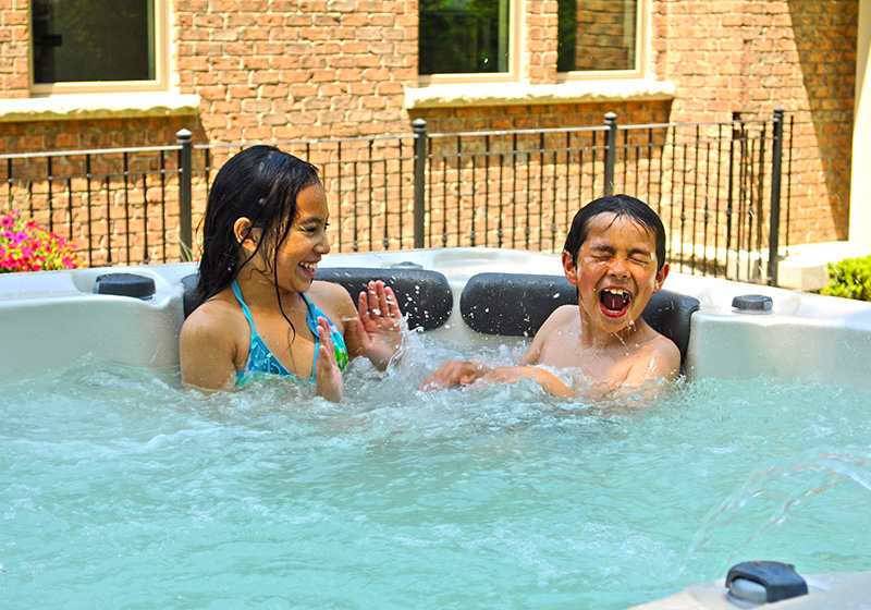 Kids splashing in hot tub