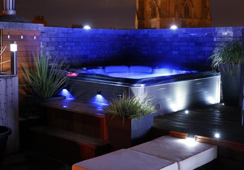 hot tub installed in night garden