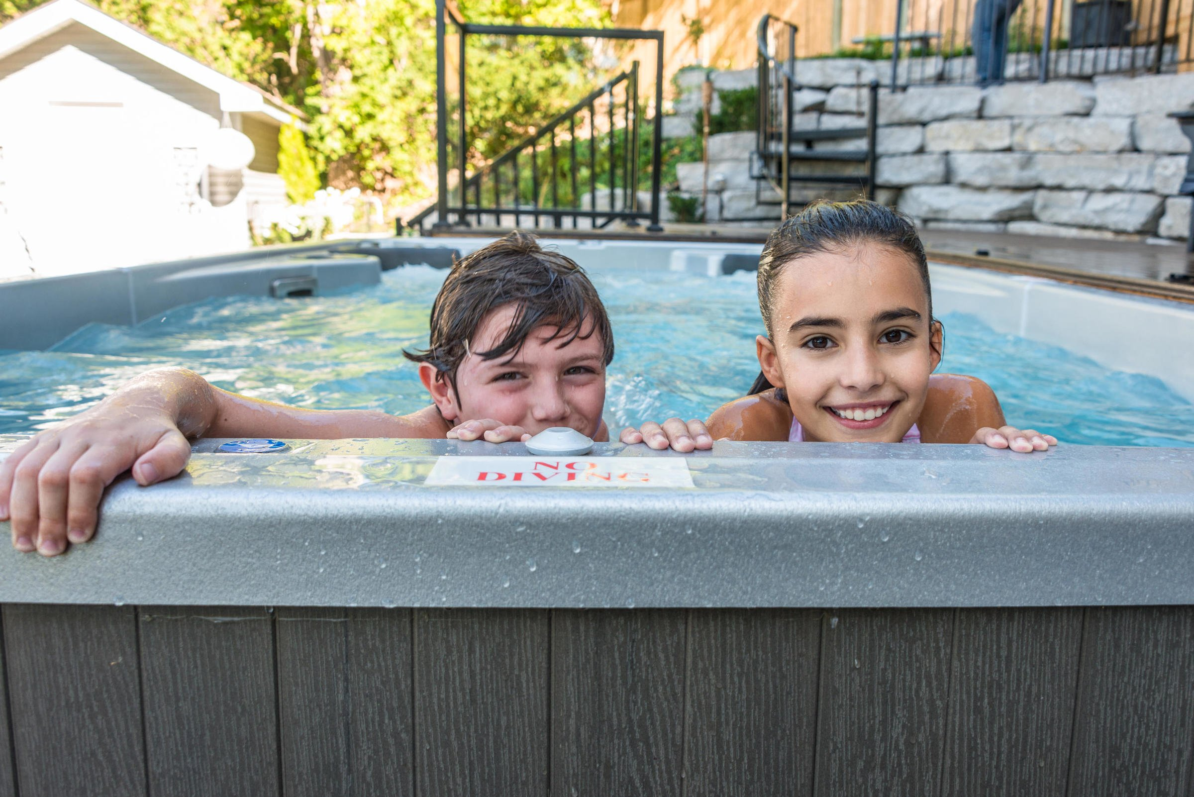Kids playing in swim spa