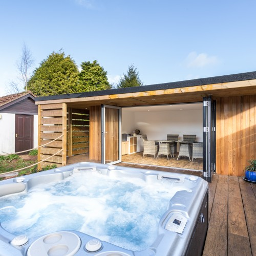 Hot tub with decking and garden room