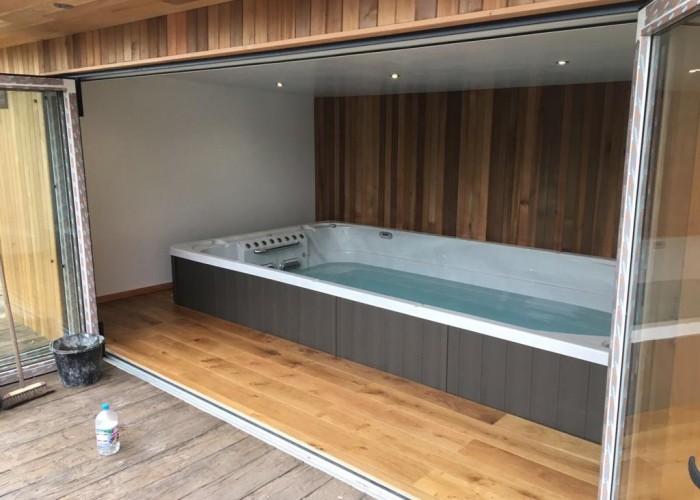 swim spa in garden room