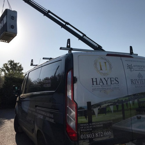 Hayes Wellness Crane lifting hot tub
