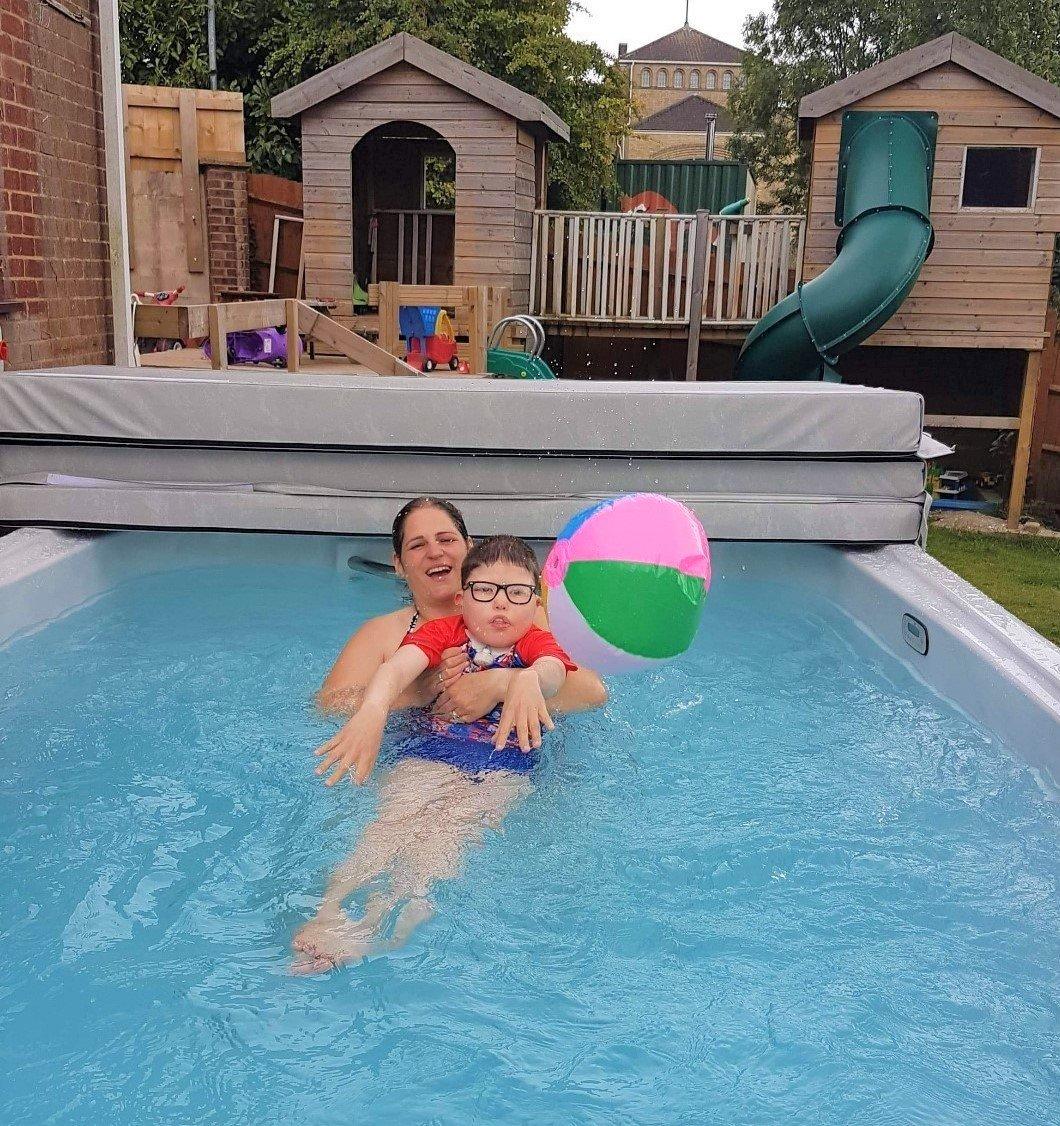 Family in swim spa